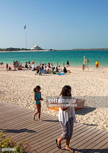 January 19 2012 Woman and children enjoying Abu Dhabi's on the beach side of the Corniche Abu Dhabi's coast is on the Arabian Sea The Abu Dhabi...