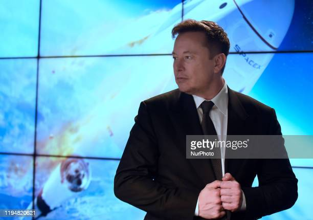 January 19 2020 Kennedy Space Center Florida United States SpaceX CEO Elon Musk prepares to depart a press conference following the successful...