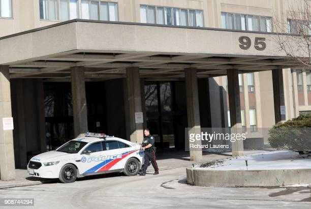 TORONTO ON January 19 A police officer leaves the entrance of the building and heads to his car 95 Thorncliffe Park Dr in East York is one of the...