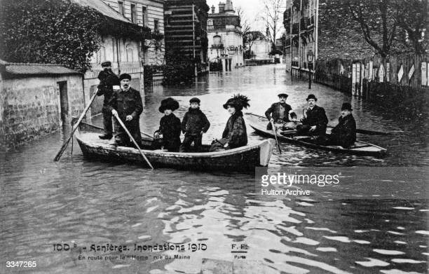 Parisians are go home by boat along the Rue du Maine during flooding in the city