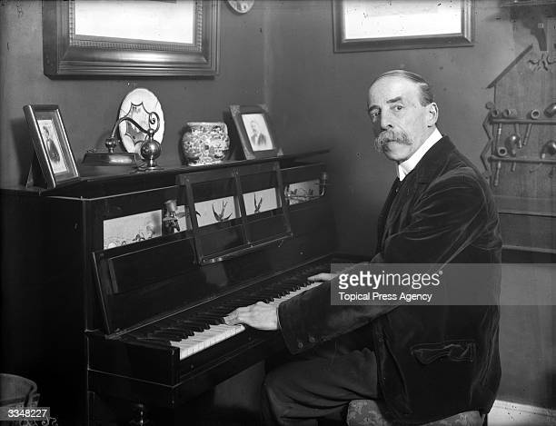 English conductor and composer Sir Frederic Hymen Cowen playing the piano at his home