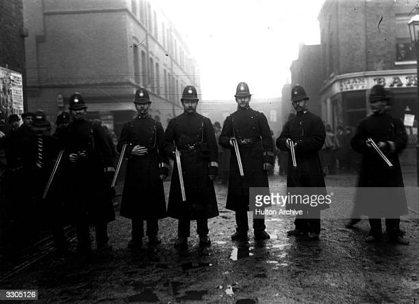 Police issued with rifles by order of the Home Secretary Winston Churchill during the Sidney Street Siege