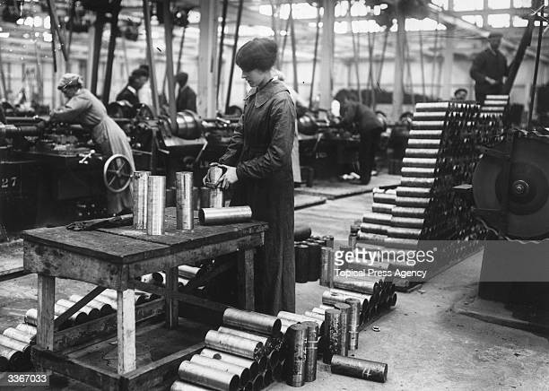 Women munitions workers in a Vickers factory maing shell cases
