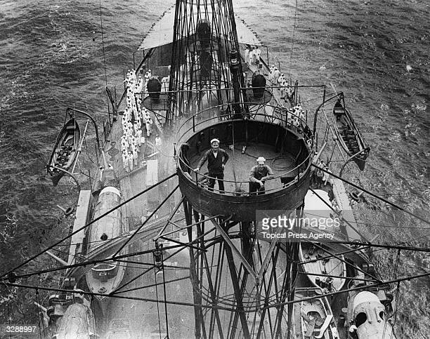 Two sailors in the crow's nest on board the American ship the 'Kentucky'