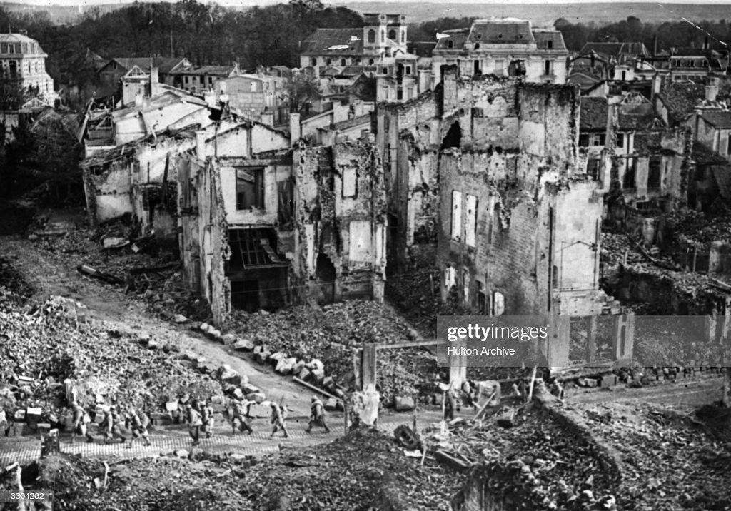 French troops passing through ruins at Verdun.