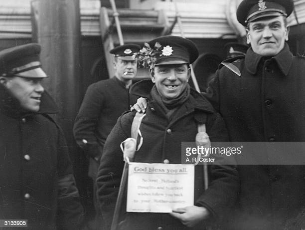 Landing of British prisoners of war at Boston Lincolnshire aboard Dutch ships between 3rd 8th January Sign reads 'God Bless You All Neutral Holland's...