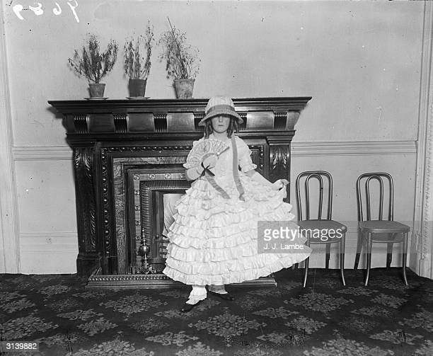 A little girl dressed like BoPeep at a children's party at the Savoy Hotel London