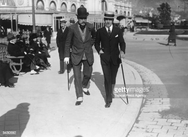 Elegant gentlemen Captain V Harding and Robert Fulton saunter down a street in Monte Carlo Monaco