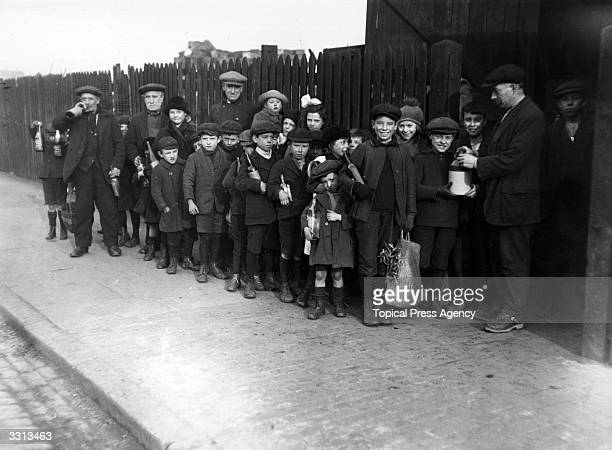 A queue of children waiting for the distribution of flu inoculations at Poplar east London