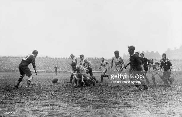A Welsh forward makes a pass as England play Wales at Cardiff
