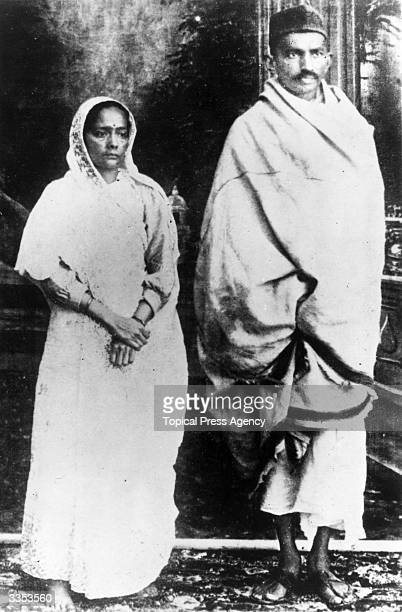 Indian nationalist leader and organizer of the Indian National Congress's campaign of passive noncooperation Mahatma Gandhi with his wife shortly...