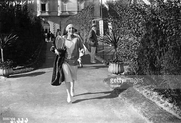 French tennis player Suzanne Lenglen arriving to compete in the Carlton Tennis Tournament on the French Riviera.