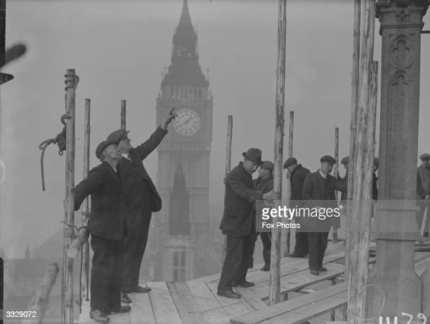 Restoration workers restore the Central Tower of the House of Commons