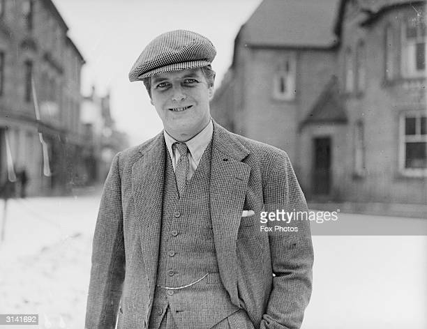 Randolph Churchill , son of Sir Winston Churchill, canvassing at Dingwall in a three-piece tweed suit and matching flat cap.