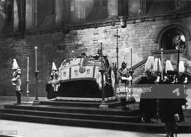 The late King George V lying in state in London's Westminster Hall surrounded by horse guards