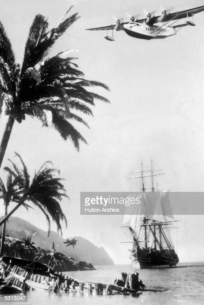A Pan American Airways flying boat aircraft passing over a clipper ship on the Spanish coast