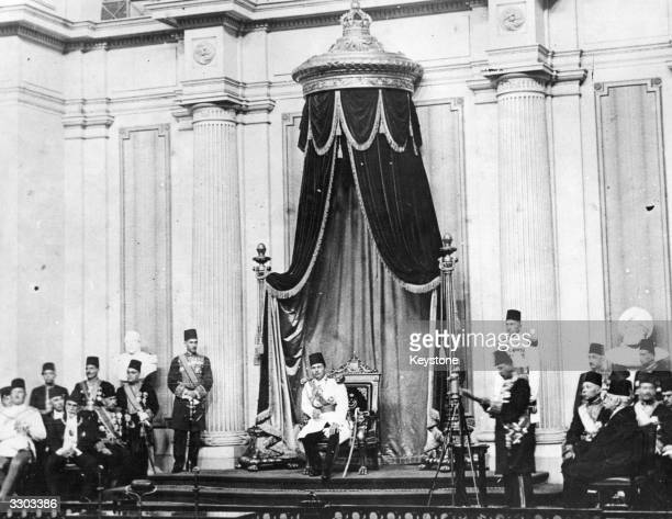 Farouk I king of Egypt from 1937 to 1952 on his throne in the Egyptian parliament building at Cairo listening to a speech by Nahas Pasha