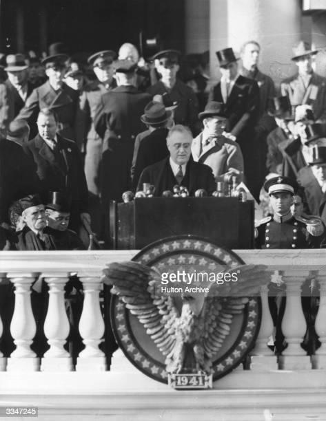 President Roosevelt delivering his inaugural address on his election to the presidency for the third time The balcony is decorated with an icon of...