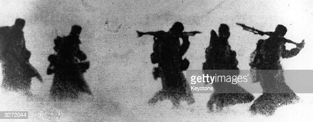 Nazi soldiers stumble through a blinding snowstorm. The Nazis' biggest enemy in Russia is the snow. Even the Panzers are helpless against this form...