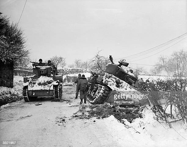 Hard going for US tanks at Amonines Belgium on the northern flank of the 'battle of the bulge' A tank on the road passes another being dug out of the...