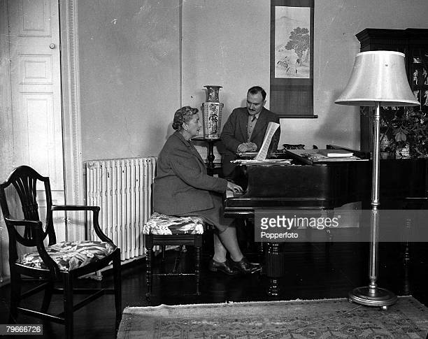 January 1946 British Crime Author Agatha Christie playing the piano for her husband Max Mallowan in their Devonshire home Greenway House