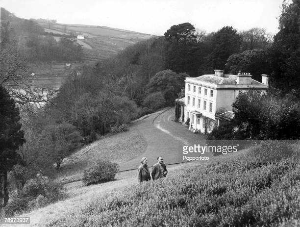 January 1946 British Crime Author Agatha Christie talks with her husband Max Mallowan as they walk outside their Devonshire home Greenway House