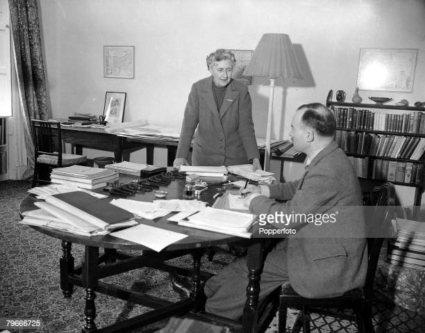 January 1946 British Crime Author Agatha Christie talks with her husband Max Mallowan in his study at their Devonshire home Greenway House