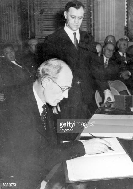 The Ambassador from Great Britain Lord Halifax signing the Bretton Woods Pacts for the United Kingdom at the State Department in Washington which saw...
