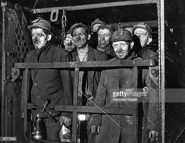 A group of coal miners in the lift at a mine Original Publication Picture Post 4294 NCB Takes Over Mines unpub