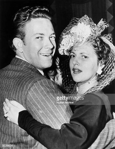 American actor Diana Barrymore daughter of actor John Barrymore and her fiance professional tennis player John Howard dancing together at the Stork...