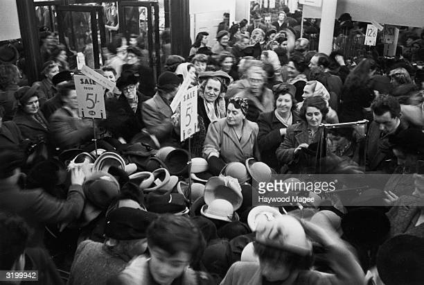 Bargain hunters in a London store during the January sales PP 4966 Vol 46 No 3 Women Into Action Pub 1950