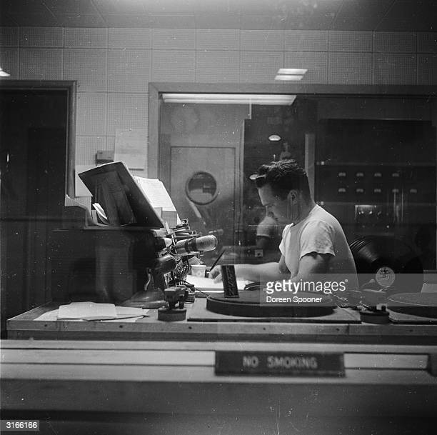 A disc jockey on the air at KRSN the radio station of Los Alamos in New Mexico This remote city is the site of the Los Alamos National Laboratory and...