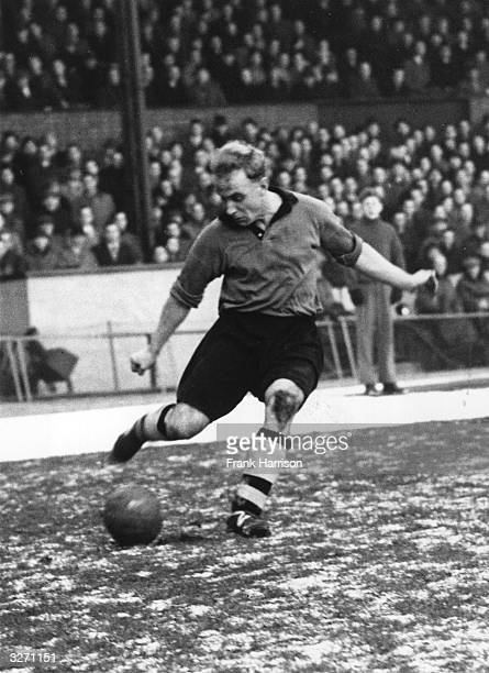 Billy Wright captain of Wolverhampton Wanderers and England in action for Wolves