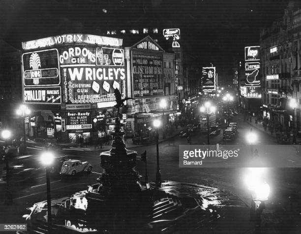 Illuminated signs dominate Piccadilly Circus at night
