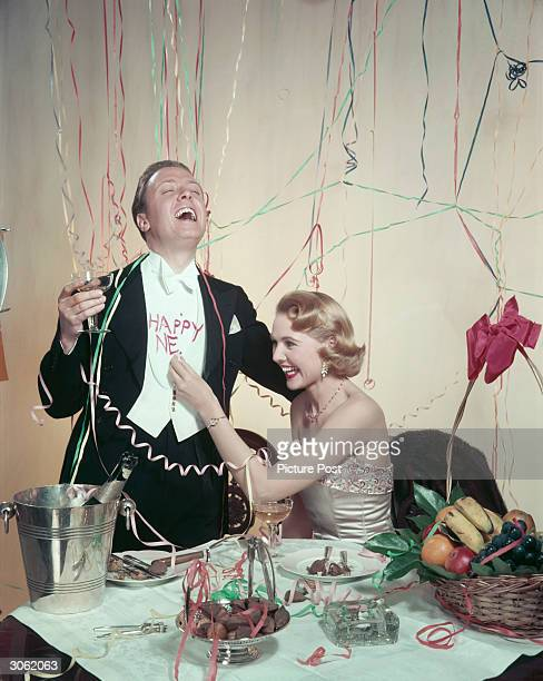 Richard Attenborough and his wife Sheila Sim bring in the New Year in style.