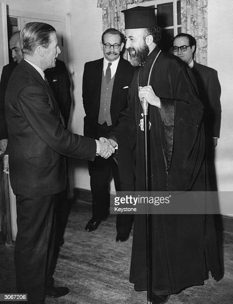 Field Marshal Sir John Harding , Governor General of Cyprus shaking hands with Archbishop Makarios at a secret meeting in Nicosia. Behind is John...