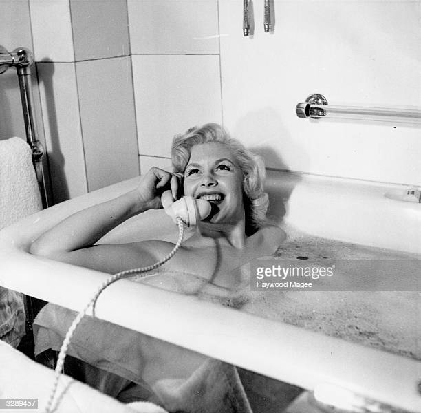 Magda Miller, the film actress, born in Scotland of a Russian mother takes a phone call whilst in her bath at the Savoy Hotel. Original Publication:...