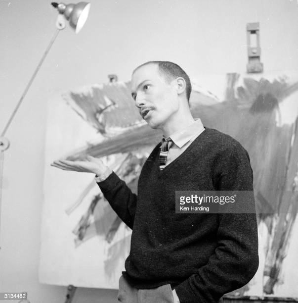 Richard Smith a young artist whose work is on display at the Institute of Contemporary Arts in London shows off one of his paintings in his west...