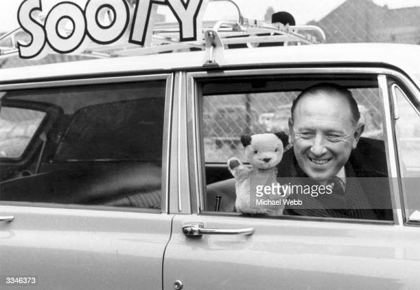 Sooty and popular glove puppet entertainer Harry Corbett in their Sooty car