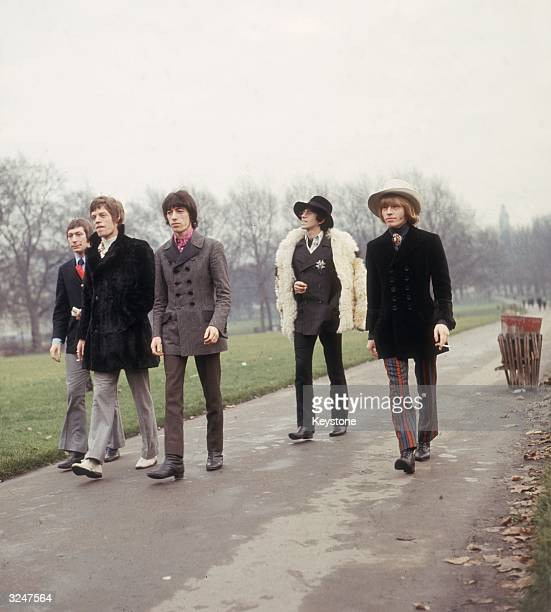 The Rolling Stones take a stroll in a London park Left to right Charlie Watts Mick Jagger Bill Wyman Keith Richards and Brian Jones