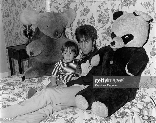 British rock singer songwriter and guitarist John Lennon of Beatles fame with his son Julian at their home in Weybridge