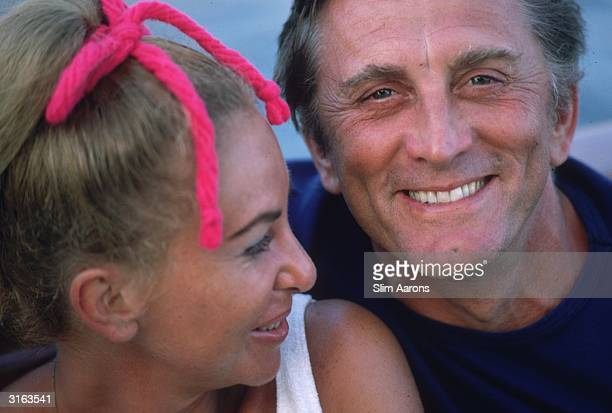 Film star Kirk Douglas with Anne Buydens in Acapulco