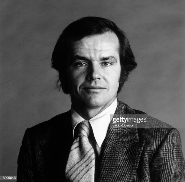 Headshot studio portrait of American actor Jack Nicholson wearing a blazer and a necktie
