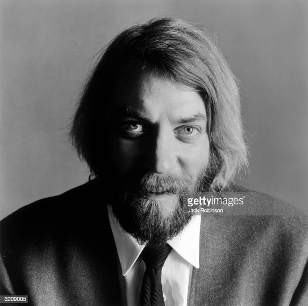 Studio headshot portrait of Canadianborn actor Donald Sutherland wearing a gray blazer and a necktie