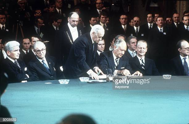 American Secretary of State William Rogers signing the Vietnam peace treaty in Paris Also present to sign are Nguyen Duy Trinh North Vietnam's...