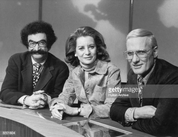 American broadcast journalists Gene Shalit, Barbara Walters, and Frank McGee sit behind the news desk in a promotional portrait for the 'Today Show,'.