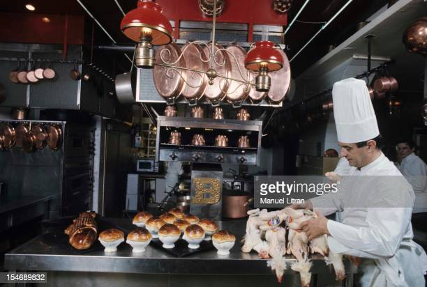 January 1973 the great chef Paul Bocuse at his restaurant 'L'Auberge du Pont de Collonges' has CollongesauMontd'Or In the kitchen the cap hat he...