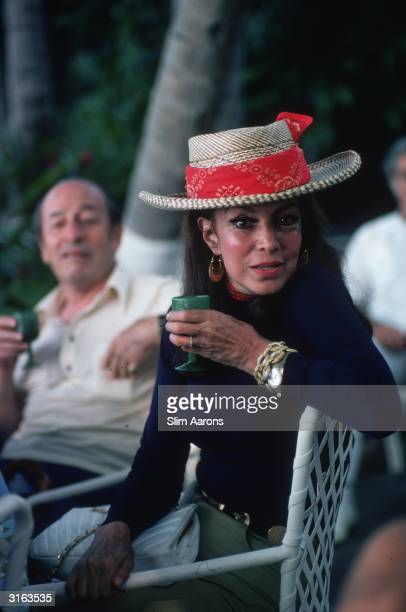 Mexican actress Maria Felix enjoying a drink in Acapulco