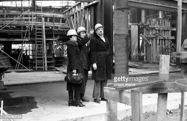 The Gewandhauskapellmeister Kurt Masur visits the construction site of the New Gewandhaus in Leipzig on KarlMarxPlatz at the end of the 1970s...
