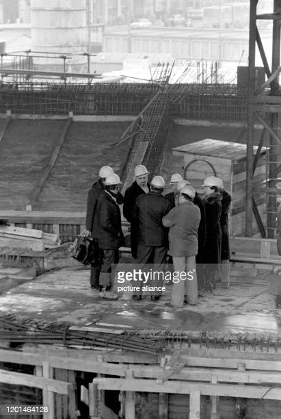 January 1979, Saxony, Leipzig: The Gewandhauskapellmeister Kurt Masur visits the construction site of the New Gewandhaus in Leipzig on...